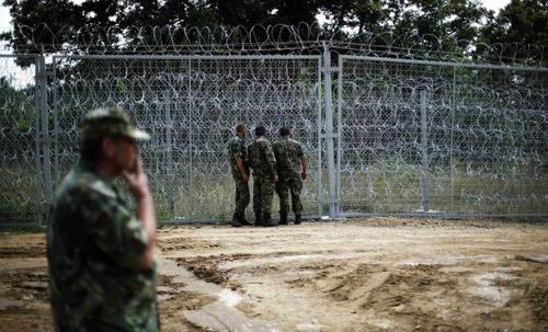 'A Bulgar to climb!'--Bulgarian military personnel inspect a barbed wire fence constructed on the Bulgarian-Turkish border