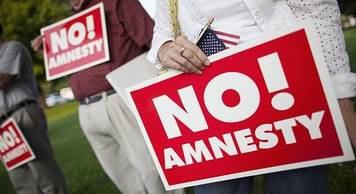 Attendees hold 'no amnesty' signs protesting against amnesty for illegal immigrants during a Richmond Tea Party rally August 12, 2013 in Richmond, Virginia. (M. Scott Mahaskey/POLITICO)
