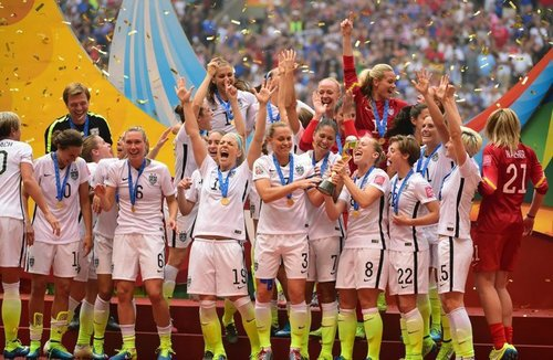 Jul 5, 2015; Vancouver, British Columbia, CAN; United States players react as they receive the FIFA Women's World Cup trophy after defeating Japan in the final of the FIFA 2015 Women's World Cup at BC Place Stadium. The United States won 5-2. Mandatory Credit: Anne-Marie Sorvin-USA TODAY Sports ORG XMIT: USATSI-230322 ORIG FILE ID:  20150705_gma_as9_103.jpg