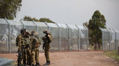 Israeli soldiers patrol next to the border fence on border with Syria, in the Israeli-annexed Golan Heights.