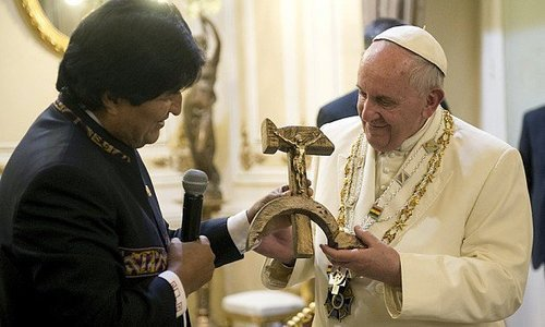 Bolivian President Evo Morales presents Pope Francis with a wooden crucifix carved in the form of a hammer and sickle