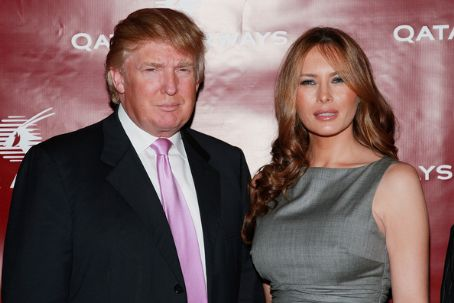 Trump with wife Melania (not acquired through eminent domain)