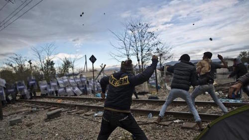"Muslim ""migrants""throw stones at Macedonian policemen."