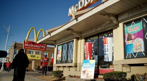 A Muslim woman passing McDonalds in Hamtramck. (At least, it's supposed to be a Muslim woman--but it could be anybody.)