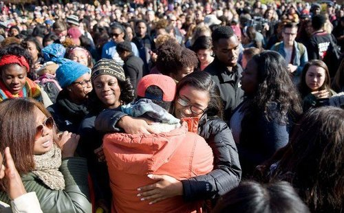 Black protesters celebrate their victory over the University of Missouri.  Credit: VDare.com