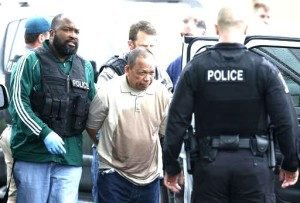 Police take Eulalio Tordil, 62, a suspect in three fatal shootings in the Washington, D.C., area into custody in Bethesda, Md., Friday, May 6, 2016. Tordil is an employee of the Federal Protective Service, which provides security at federal properties. He was put on administrative duties in March after a protective order was issued against him.